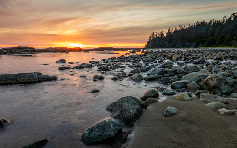 Canadian river landscape with rocks and trees at sunset